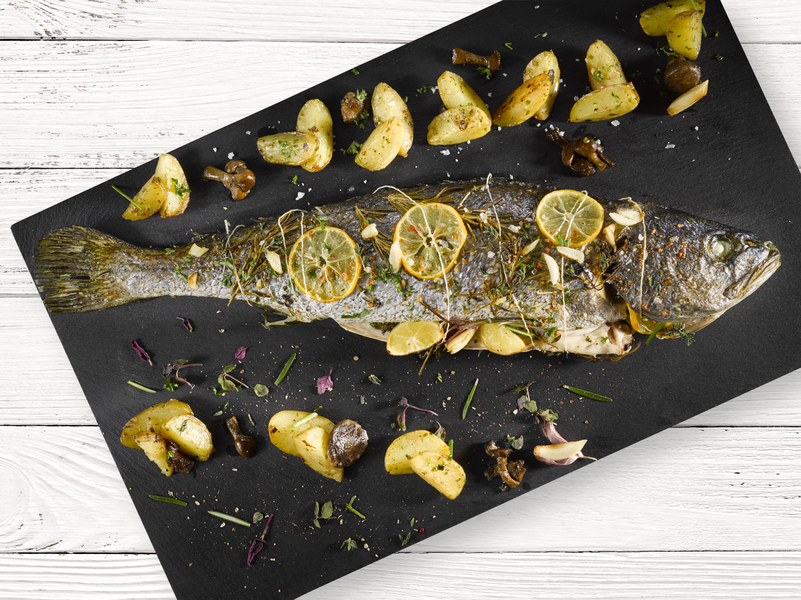 BAKED AVRAMAR CORVINA WITH LEMON AND POTATOES